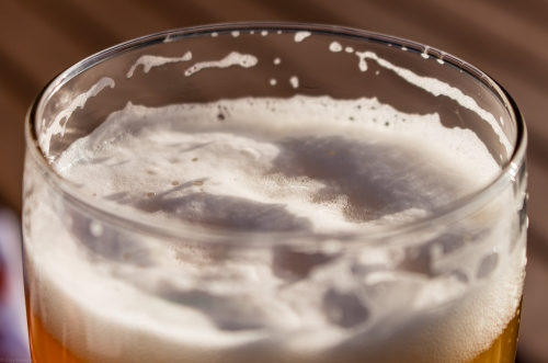 A close up of beer bubbles in sunlight